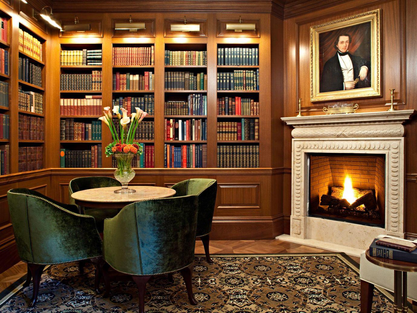 Boutique Hotels Fireplace Hotels Living Lounge indoor room floor chair home living room cabinetry estate shelf hardwood interior design wood Design mansion furniture