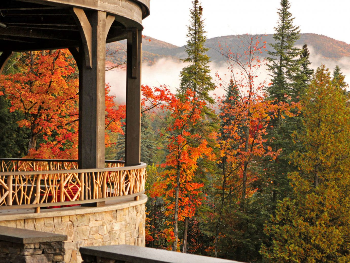 Balcony Boutique Hotels Hotels Lake Lodge Outdoors + Adventure Rustic Scenic views Trip Ideas Waterfront Weekend Getaways tree outdoor building autumn season leaf flower bridge home Garden stone