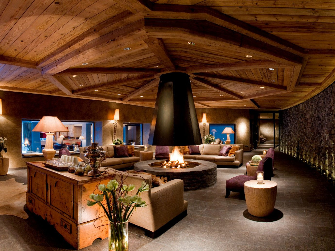 Elegant Fireplace Forest Honeymoon Lounge Luxury Mountains Nature Outdoors Romance Ski Trip Ideas Winter ceiling indoor floor room recreation room estate billiard room home interior design log cabin lighting living room wood Lobby Design Resort mansion cottage furniture area