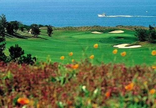 grass water sky Ocean structure ecosystem grassland Nature sport venue outdoor recreation golf course field meadow lawn plain