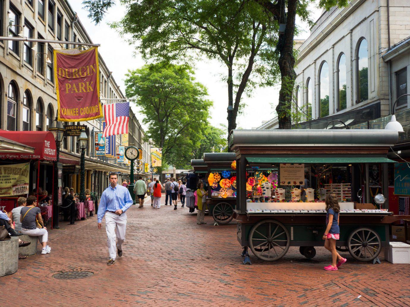 People walking down a street in Boston.