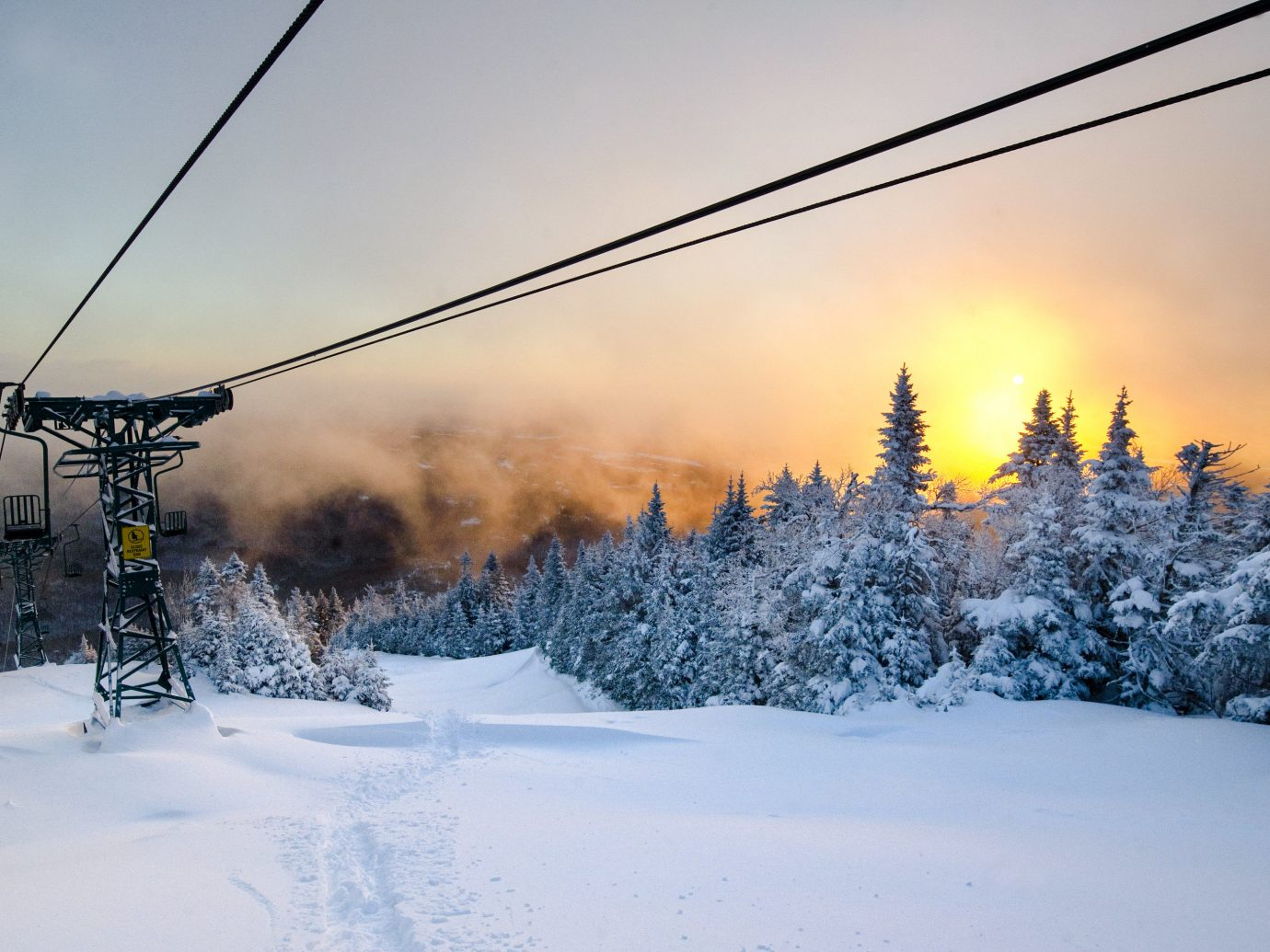 alpine skiing East Coast USA Trip Ideas snow sky outdoor Winter ski tow Nature transport freezing tree woody plant frost light morning geological phenomenon cloud atmosphere sunlight mountain mountain range ice evening landscape fir arctic plant branch pine family