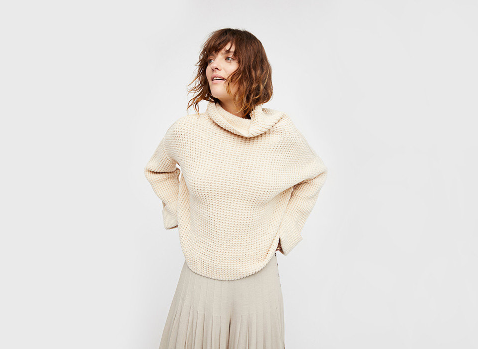 Hotels Iceland Packing Tips Style + Design Travel Tips Trip Ideas person clothing neck shoulder woolen sleeve sweater fashion model poncho beige photo shoot
