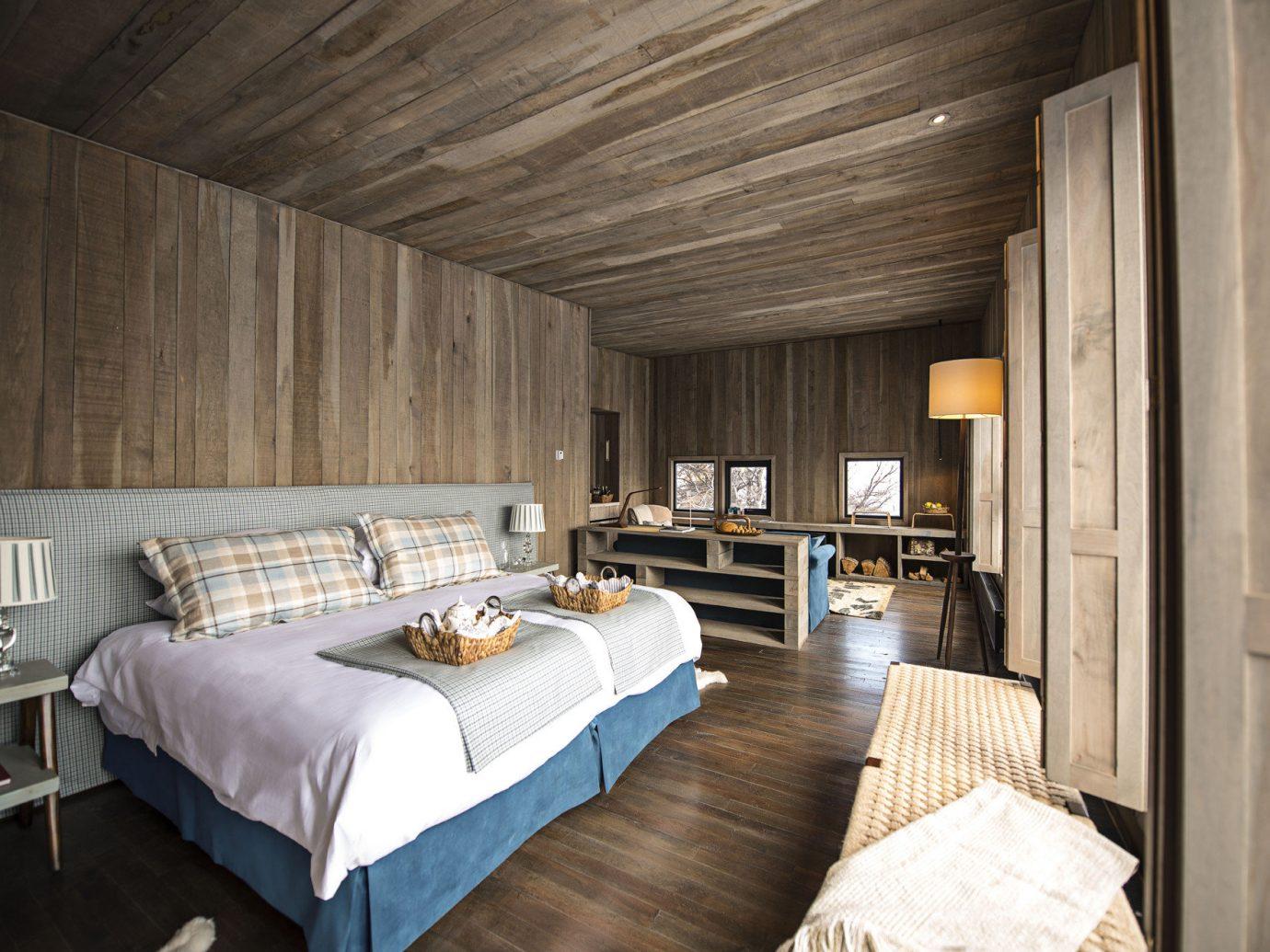 Hotels indoor bed ceiling room property Bedroom living room estate interior design floor cottage home wood hotel real estate farmhouse Design loft furniture