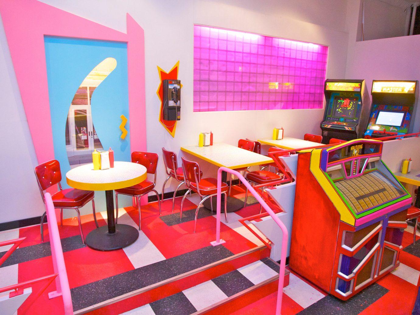 Arts + Culture floor indoor chair room interior design recreation room classroom Resort restaurant area furniture