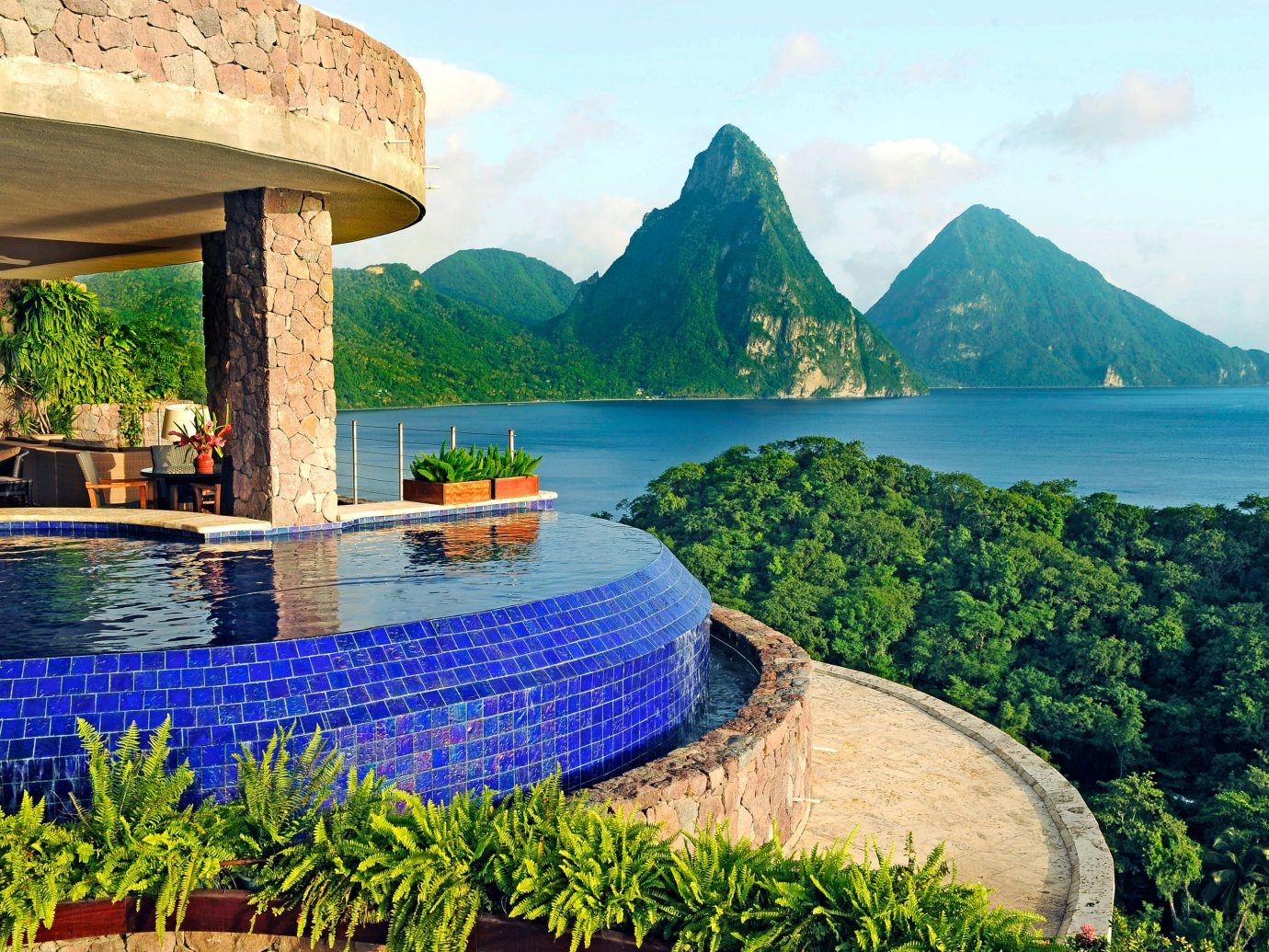 Balcony Hotels Island Jungle Luxury Pool Scenic views mountain water sky outdoor Lake Boat River vacation Sea tourism Coast estate Ocean bay landscape background Resort flower travel overlooking surrounded