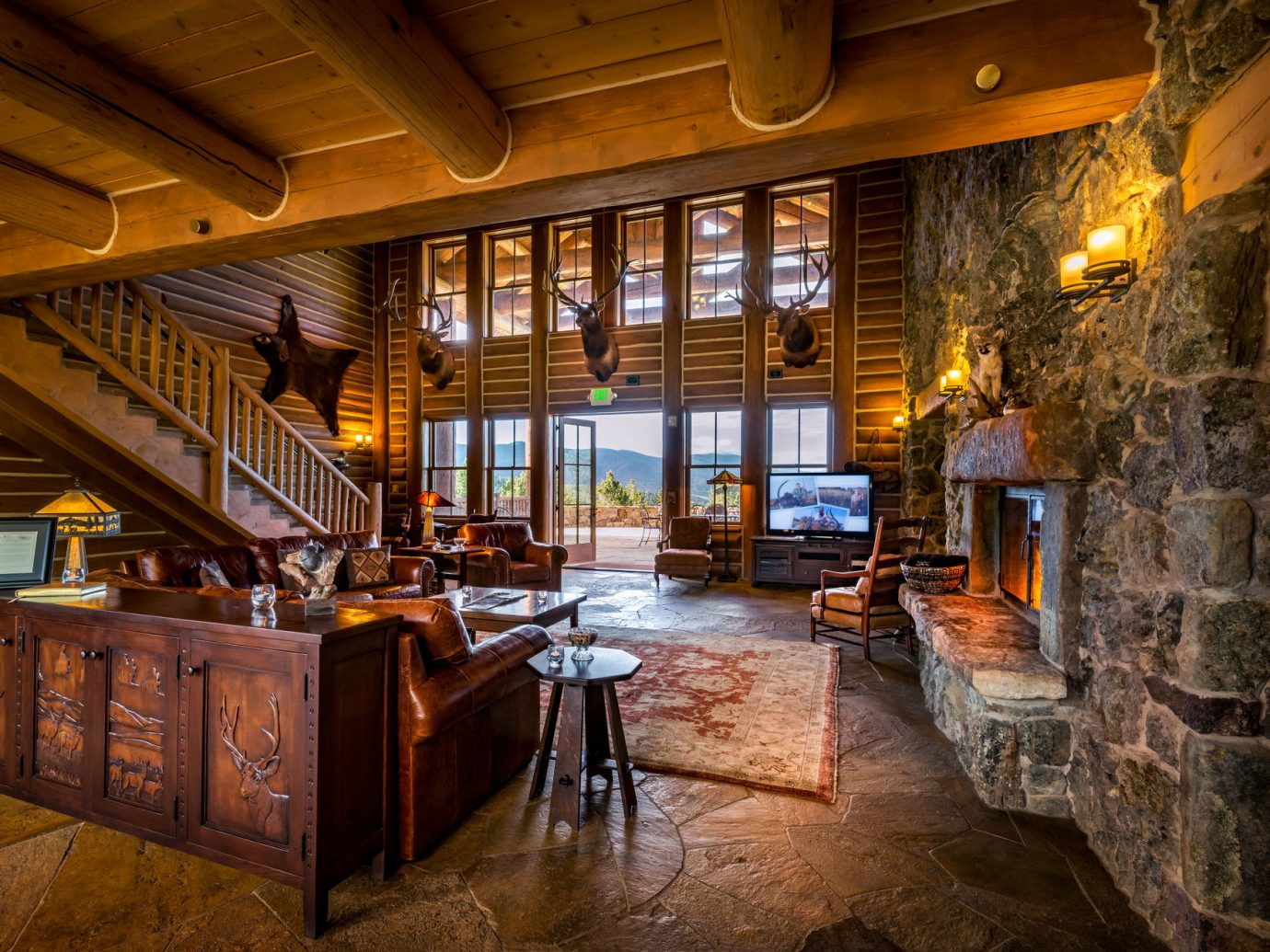 ambient lighting Cabin calm cozy extravagant Fireplace isolation Lodge log cabin Lounge Luxury Mountains Nature Outdoors remote Rustic serene Trip Ideas view warm indoor ceiling room estate building house home interior design wood restaurant Bar tavern furniture stone