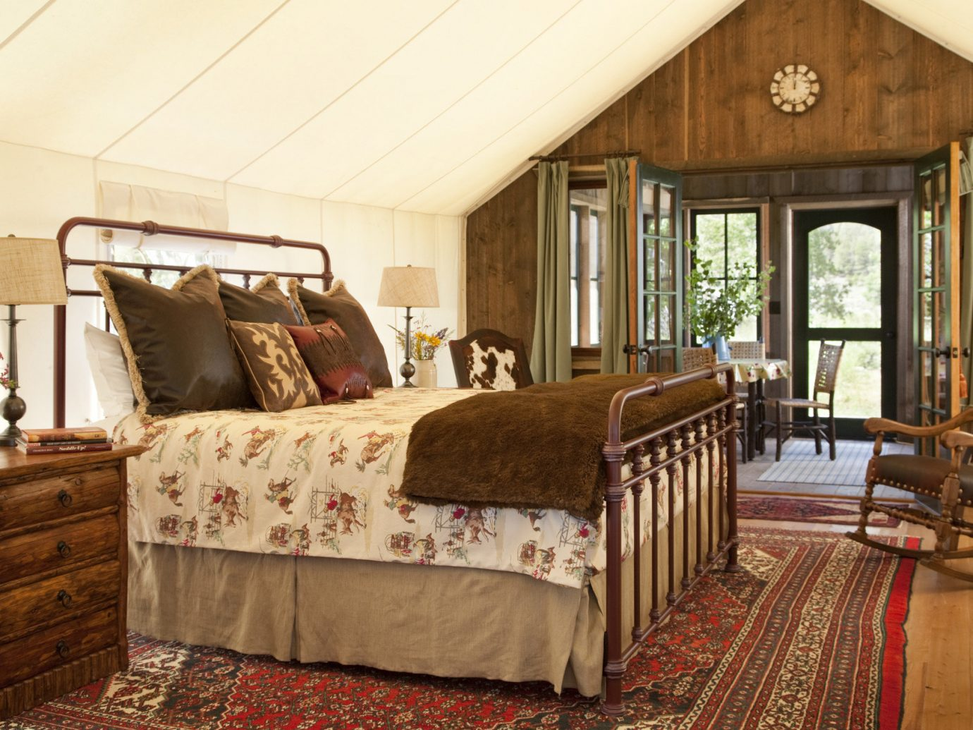 All-Inclusive Resorts Glamping Hotels Montana Outdoors + Adventure Romance Trip Ideas indoor room floor sofa wall Living property Bedroom home estate cottage living room hardwood farmhouse real estate interior design porch log cabin bed furniture bed sheet decorated