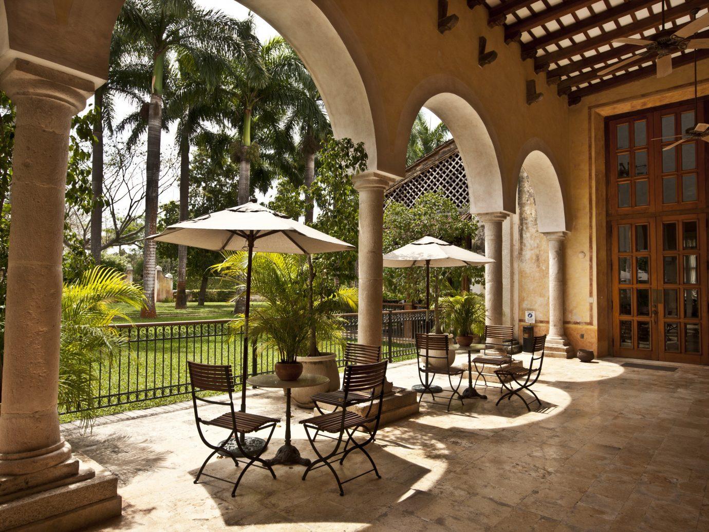 Beach Honeymoon Hotels Mexico Romance Tulum property estate Courtyard hacienda arecales real estate Patio palm tree outdoor structure tree Resort plant Villa window interior design