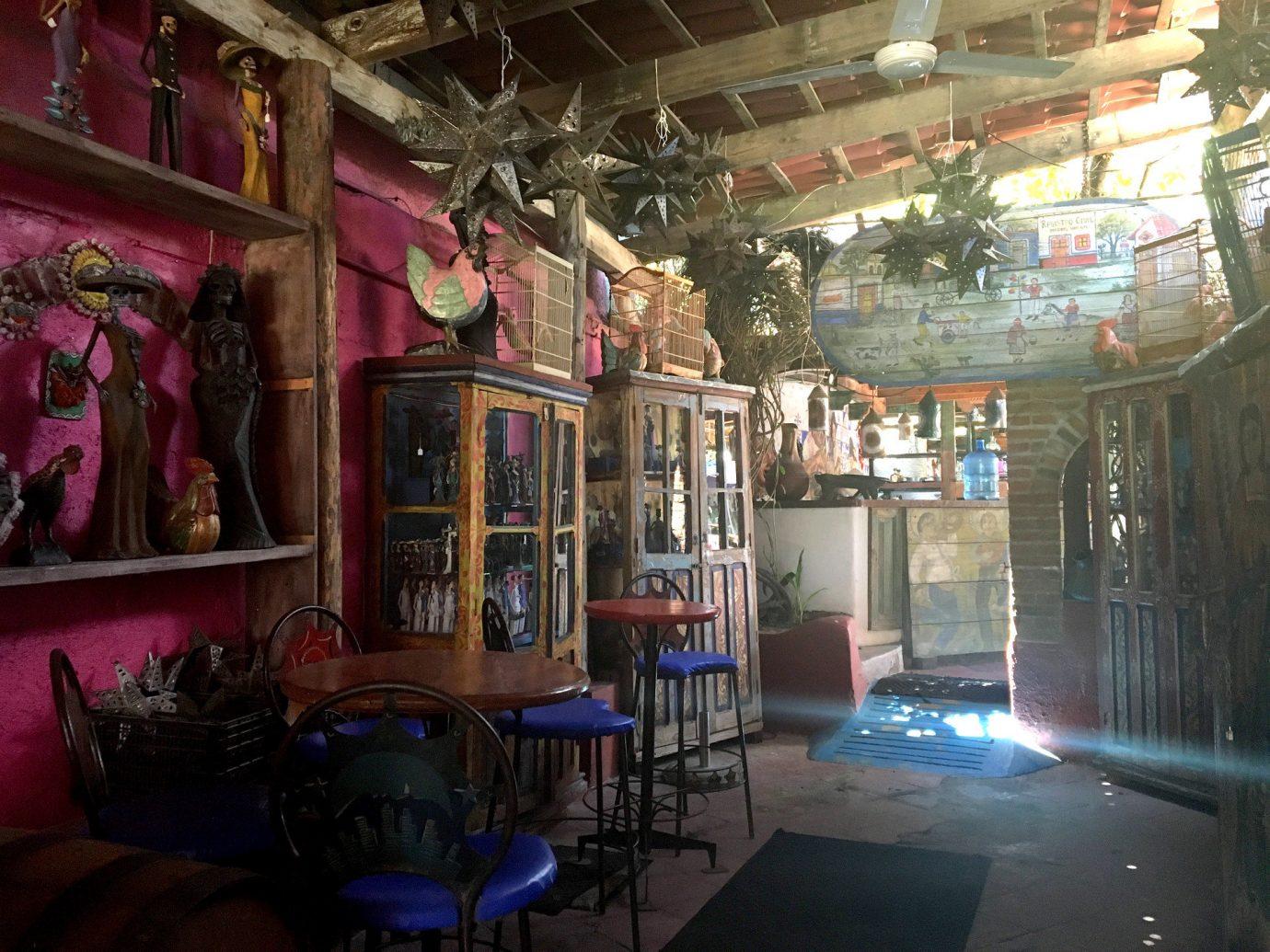artistic artsy Boutique charming interior quaint Rustic Shop store trendy Trip Ideas indoor room Living Bar tourist attraction interior design furniture area several