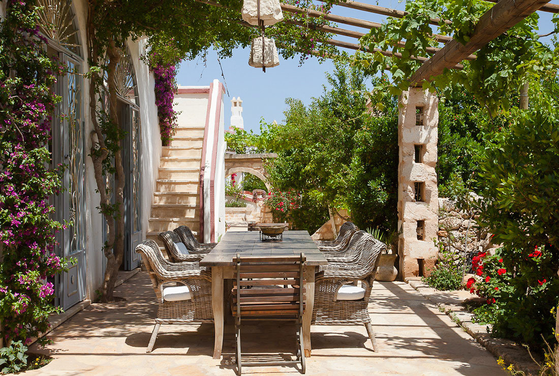 Boutique Hotels Hotels Trip Ideas tree outdoor ground building backyard outdoor structure Patio home park Courtyard real estate plant house Garden yard porch estate cottage landscaping pergola stone furniture surrounded