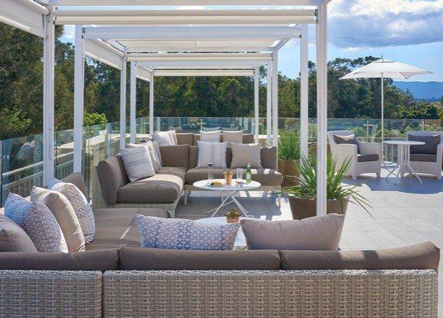 sofa property porch outdoor structure living room home condominium Patio