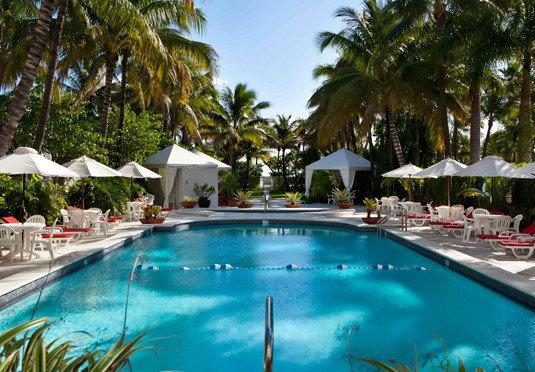 tree Pool swimming pool Resort property leisure Villa resort town caribbean swimming condominium blue lined
