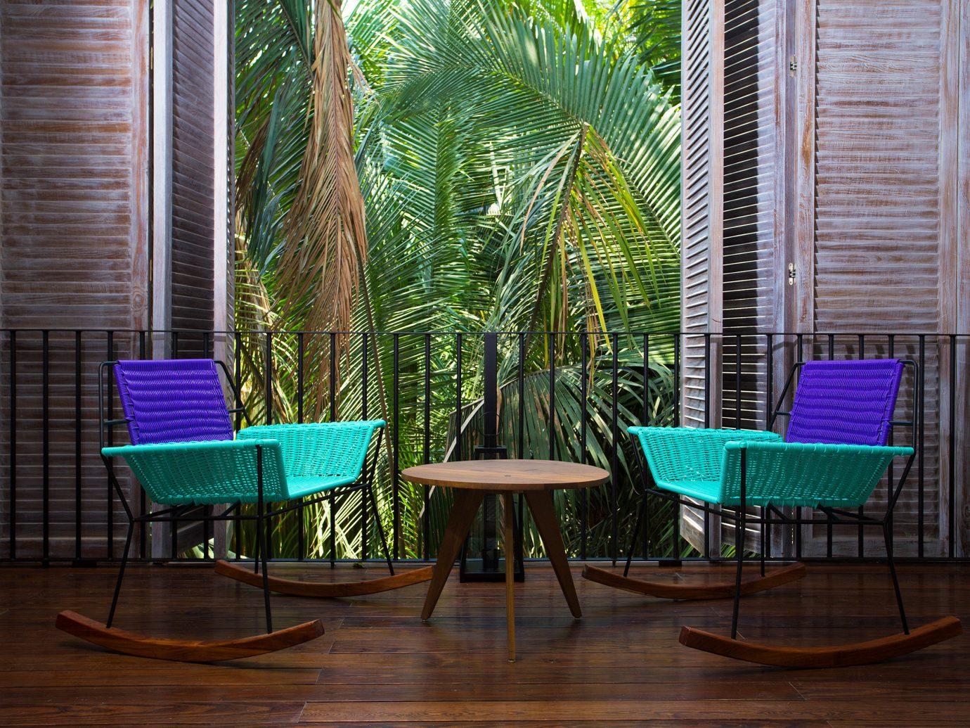 Influencers + Tastemakers Travel Shop Trip Ideas floor chair leisure indoor window room furniture wood interior design table Design backyard outdoor structure area