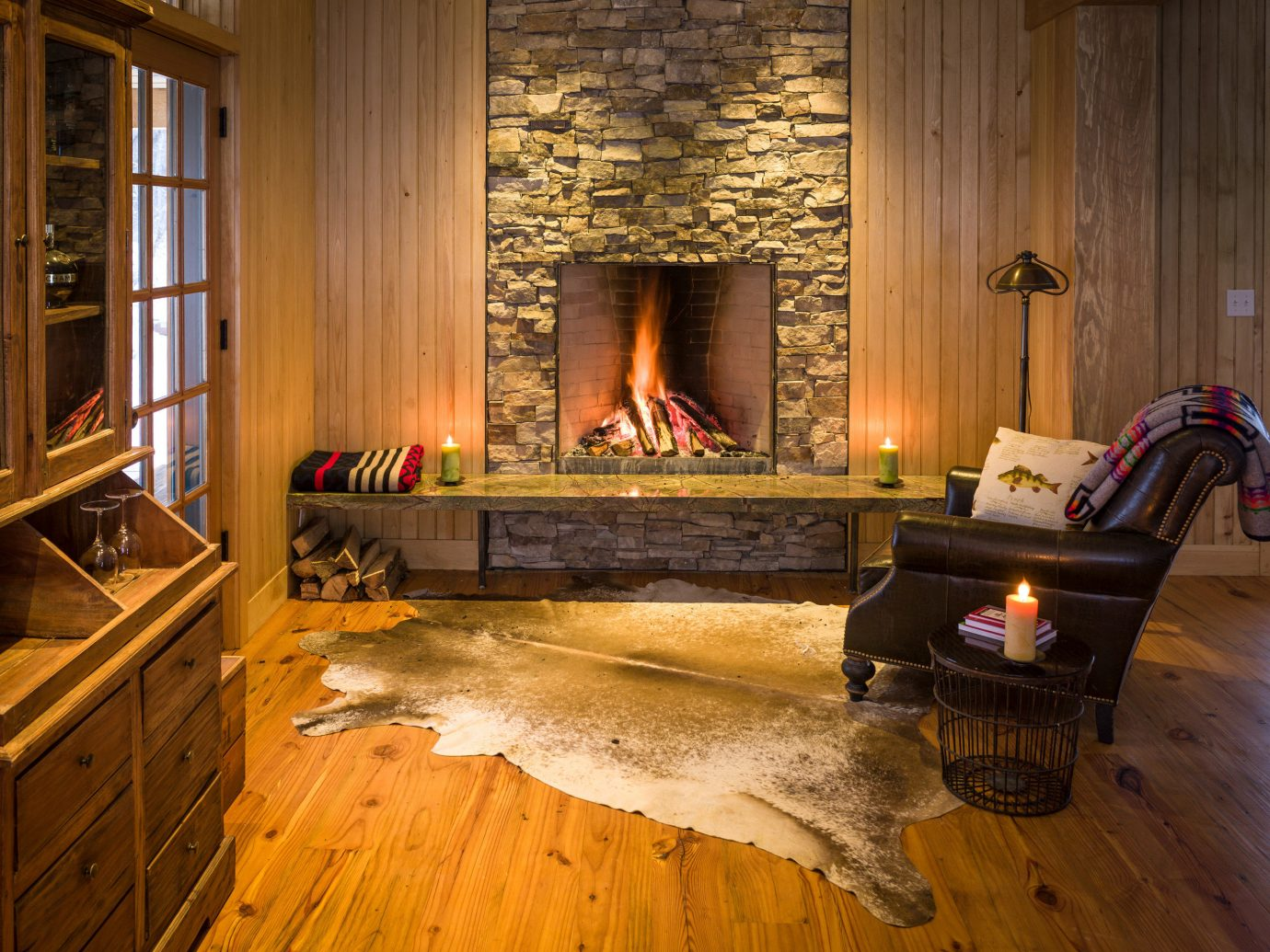 Adventure Country Forest Glamping Living Mountains Outdoors + Adventure Rustic Weekend Getaways Wellness indoor floor room building window property Fireplace home wood hearth hardwood living room house furniture estate cottage wooden wood flooring interior design farmhouse flooring hard