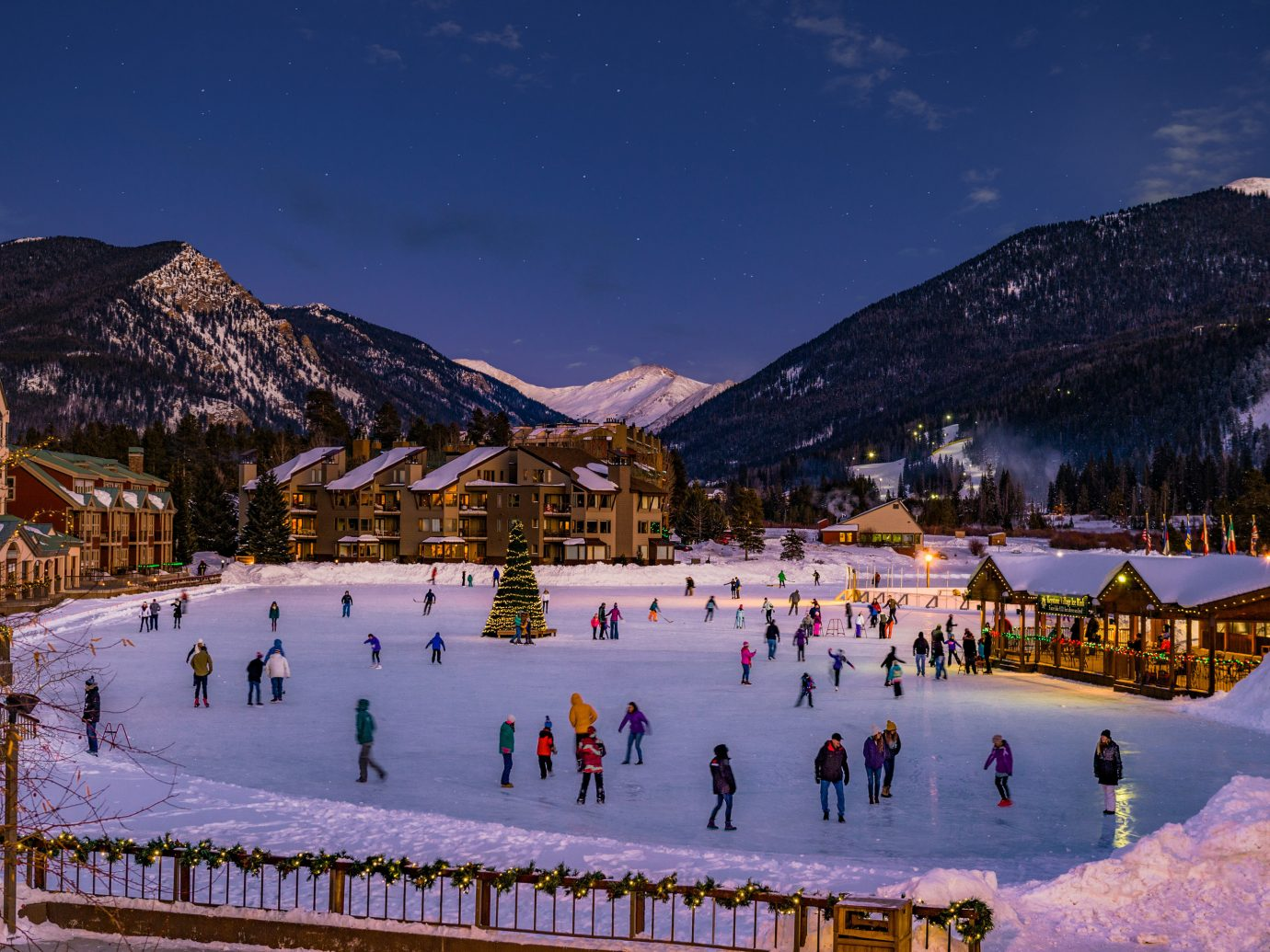 Mountains + Skiing Trip Ideas mountain sky snow outdoor skiing mountainous landforms Winter weather people mountain range Resort season group landscape evening alps piste ski slope slope