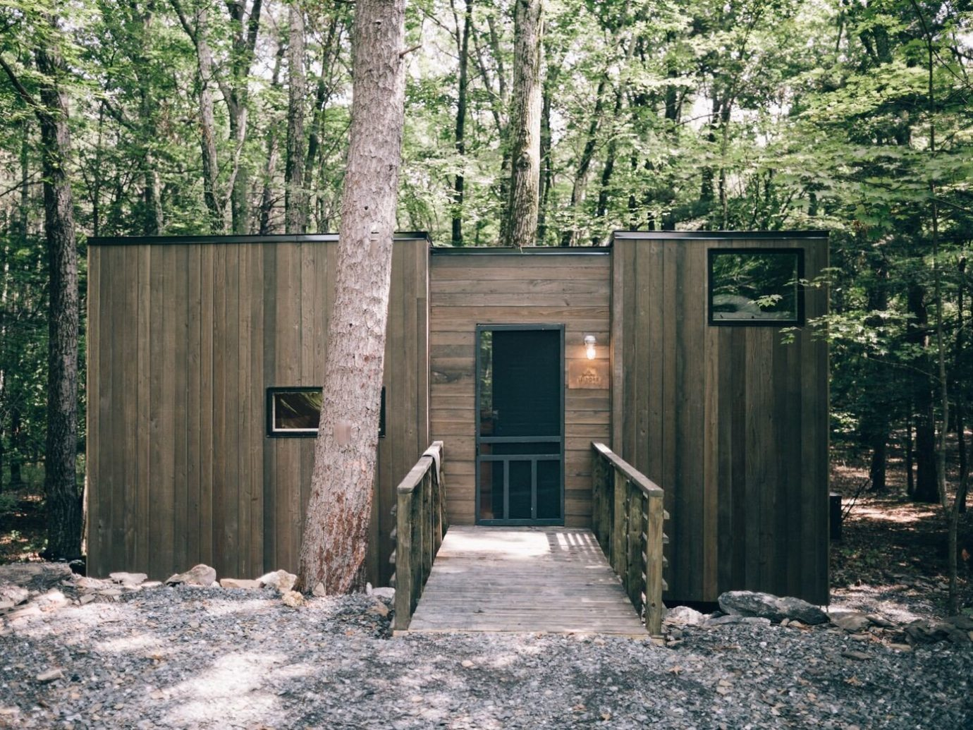 Boutique Hotels Fall Travel Hotels Outdoors + Adventure tree outdoor ground house shed Architecture cottage home outhouse shack siding wood real estate outdoor structure log cabin facade garden buildings state park hut Forest
