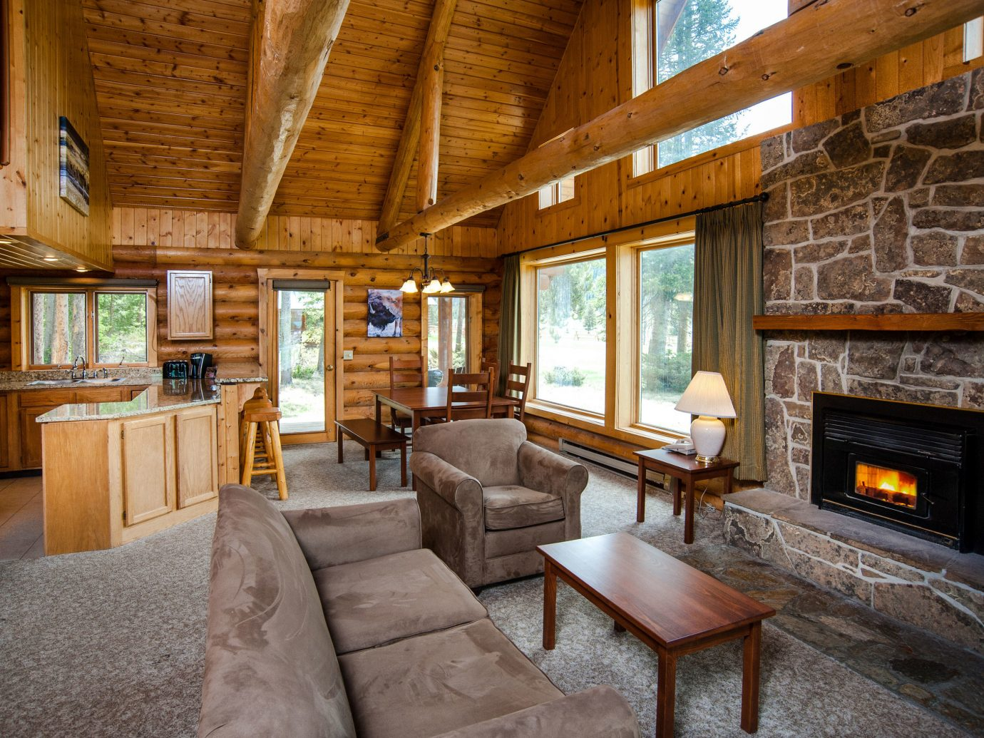 Glamping Hotels Montana Outdoors + Adventure Trip Ideas indoor Living floor room sofa Fireplace living room window ceiling interior design real estate wood home furniture beam estate house log cabin Lobby stone