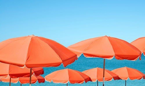 Travel Tips umbrella sky outdoor chair accessory orange lawn tent fashion accessory lined parachute wind outdoor object shade swimming day several