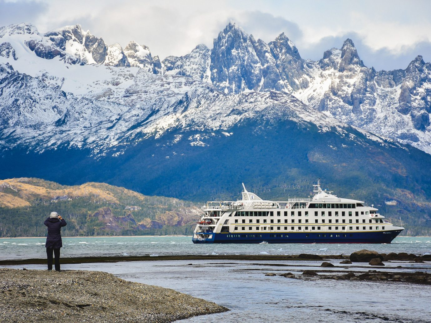 Cruise Travel Luxury Travel Trip Ideas sky mountain outdoor snow mountainous landforms Nature mountain range water cloud Lake alps glacial landform mount scenery passenger ship Winter tourism cruise ship fjord landscape reflection fell glacier tree ship national park ice