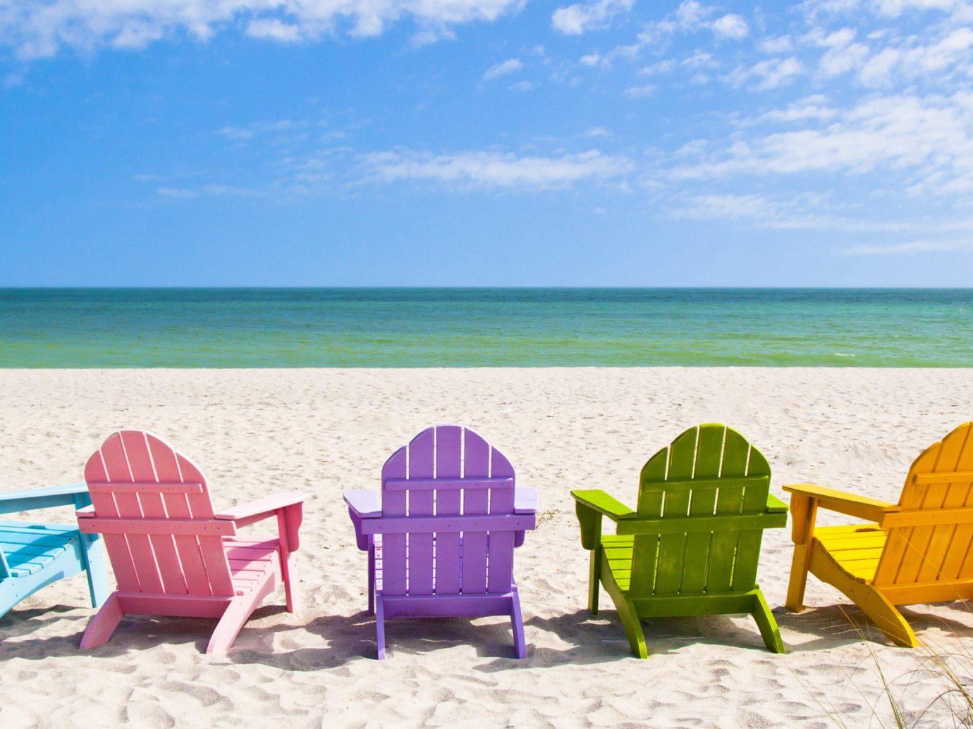 Trip Ideas outdoor sky ground chair Beach vacation Sea summer shore tourism leisure sand Ocean caribbean lawn water fun sun tanning