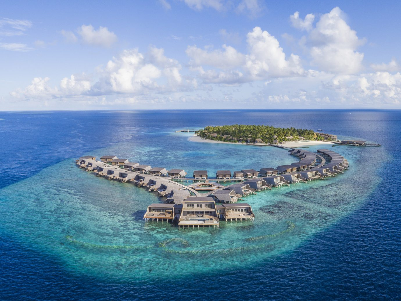 Hotels Romance Trip Ideas water sky outdoor Nature Boat reef geographical feature Sea archipelago Ocean horizon islet Coast bay blue aerial photography cape shore Island caribbean artificial island terrain clouds traveling promontory distance