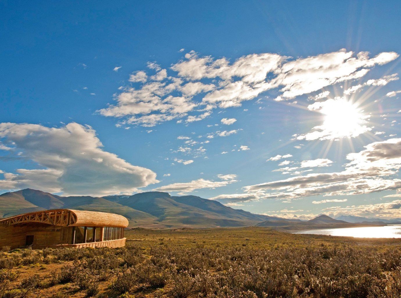 All-Inclusive Resorts Beach Hotels Mountains Nature Outdoors Romantic Hotels Waterfront outdoor sky mountain mountainous landforms geographical feature cloud horizon natural environment wilderness grassland ecosystem plain hill prairie field mountain range landscape morning plateau sunlight steppe rural area valley hillside highland