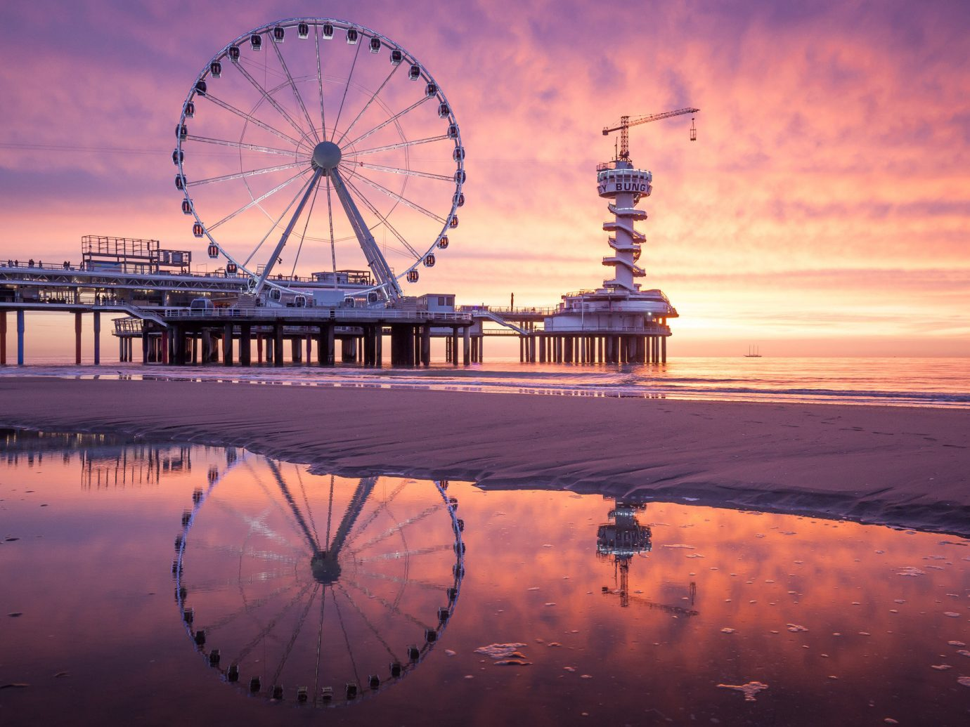 Trip Ideas sky outdoor reflection landmark tourist attraction water sunrise Sea Sunset dawn horizon dusk cloud evening ferris wheel calm fixed link