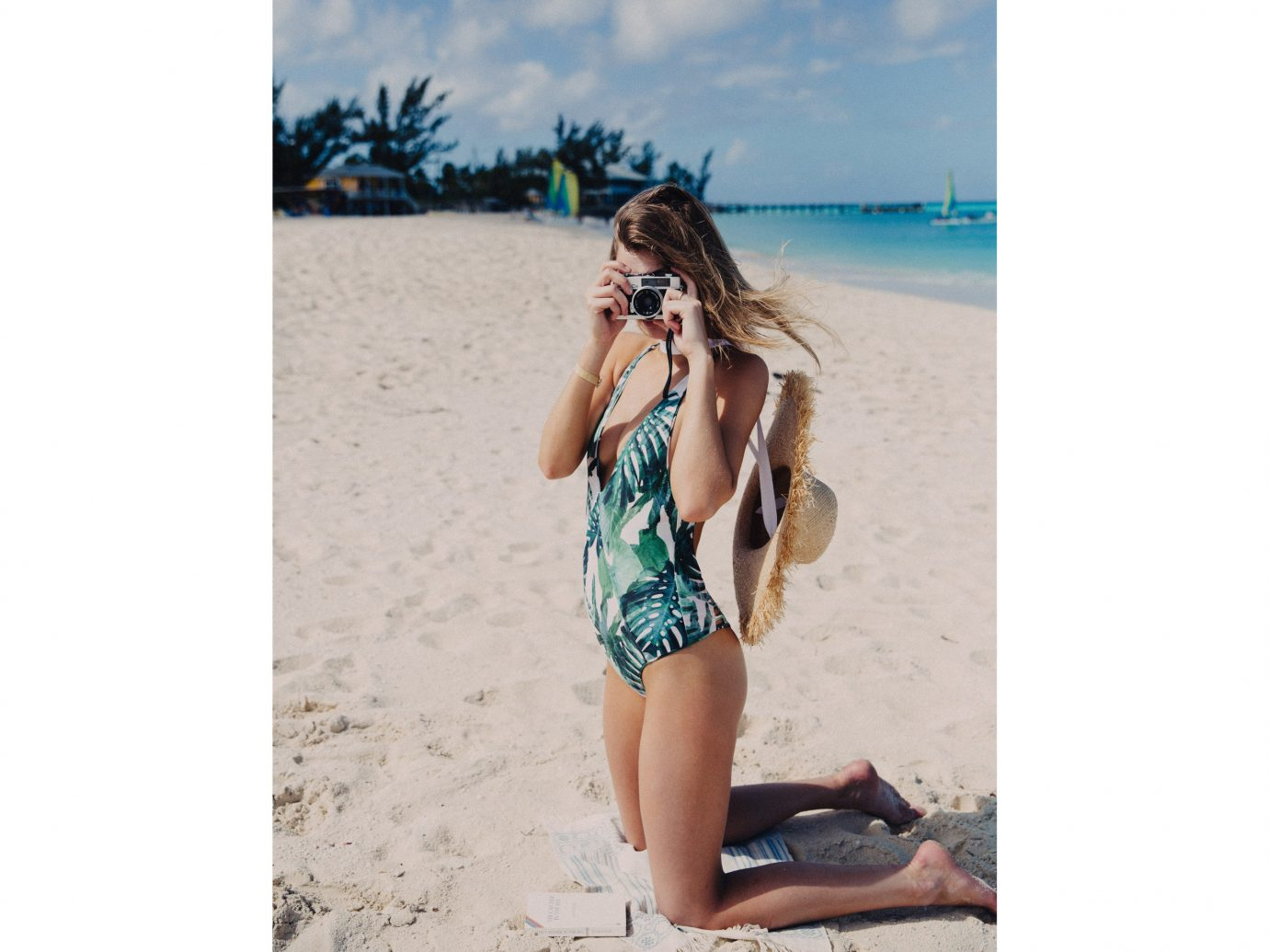 Style + Design outdoor woman Beach swimwear clothing girl person fashion model young vacation summer supermodel lady swimsuit shorts beautiful one piece swimsuit lingerie swimsuit top swimsuit bottom maillot pretty