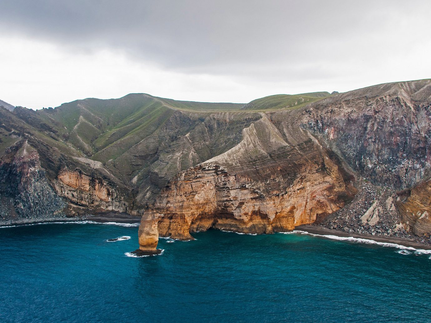 Trip Ideas mountain sky Nature water outdoor geographical feature landform Coast Sea body of water cliff bay terrain rock Ocean cape fjord cove Island