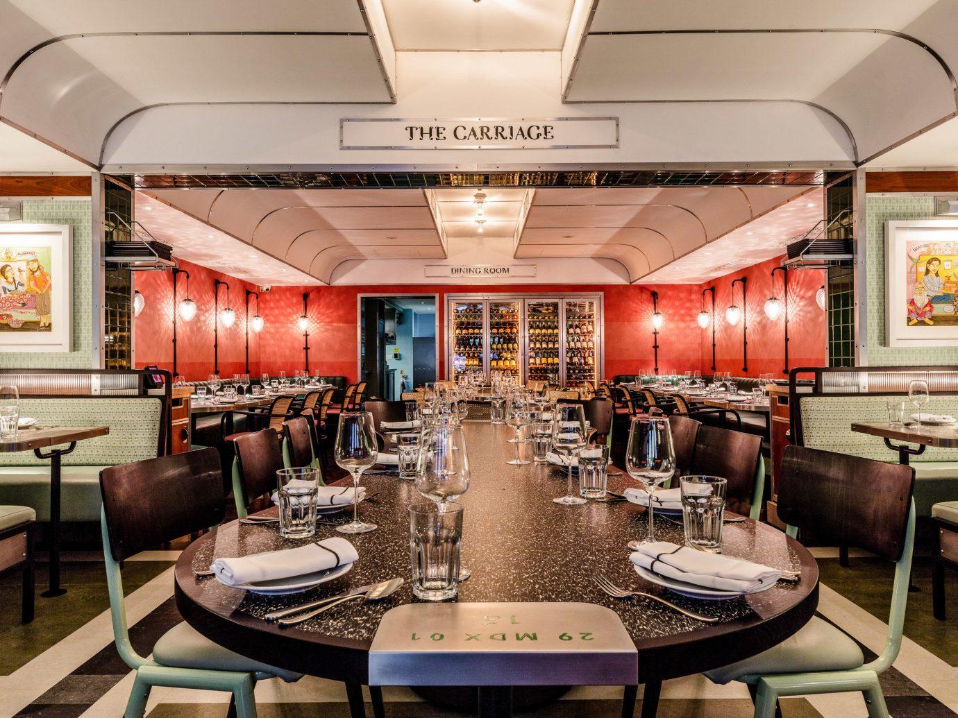 Food + Drink London table indoor restaurant interior design ceiling café several