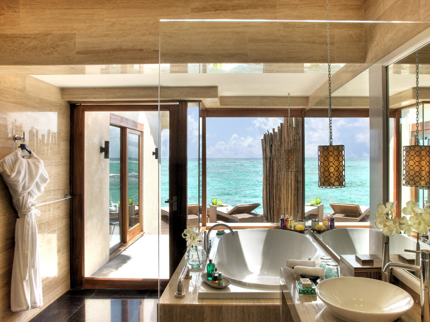 Beachfront Bedroom Family Hotels Living Resort Scenic views Villa indoor room property window estate home ceiling sink interior design swimming pool bathroom Design restaurant Suite dining room tub Island