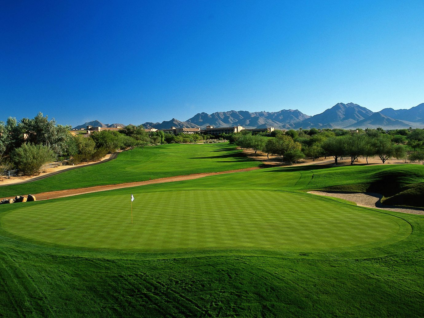 Health + Wellness Hotels Yoga Retreats grass sky outdoor structure field geographical feature Nature grassland sport venue grassy green golf course plain hill aerial photography golf club lush rural area landscape sports meadow plateau lawn day distance hillside highland