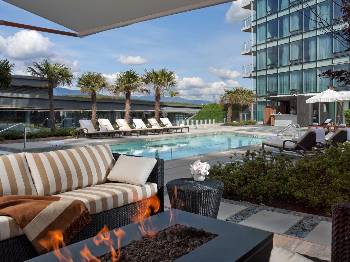 Exterior Hotels Lounge Pool property condominium swimming pool estate Resort Villa home real estate backyard apartment area furniture overlooking set
