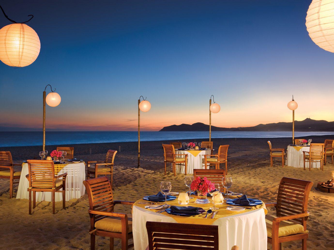 Bar Budget Dining Drink Eat Elegant Hotels Luxury Modern sky outdoor chair evening lighting restaurant Resort set Sunset several day