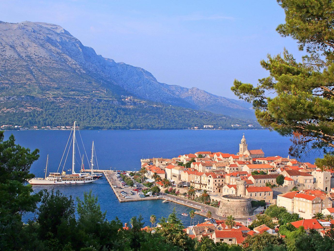 Trip Ideas tree outdoor mountain sky Town vacation Lake tourism Sea mountain range Coast fjord bay land hillside