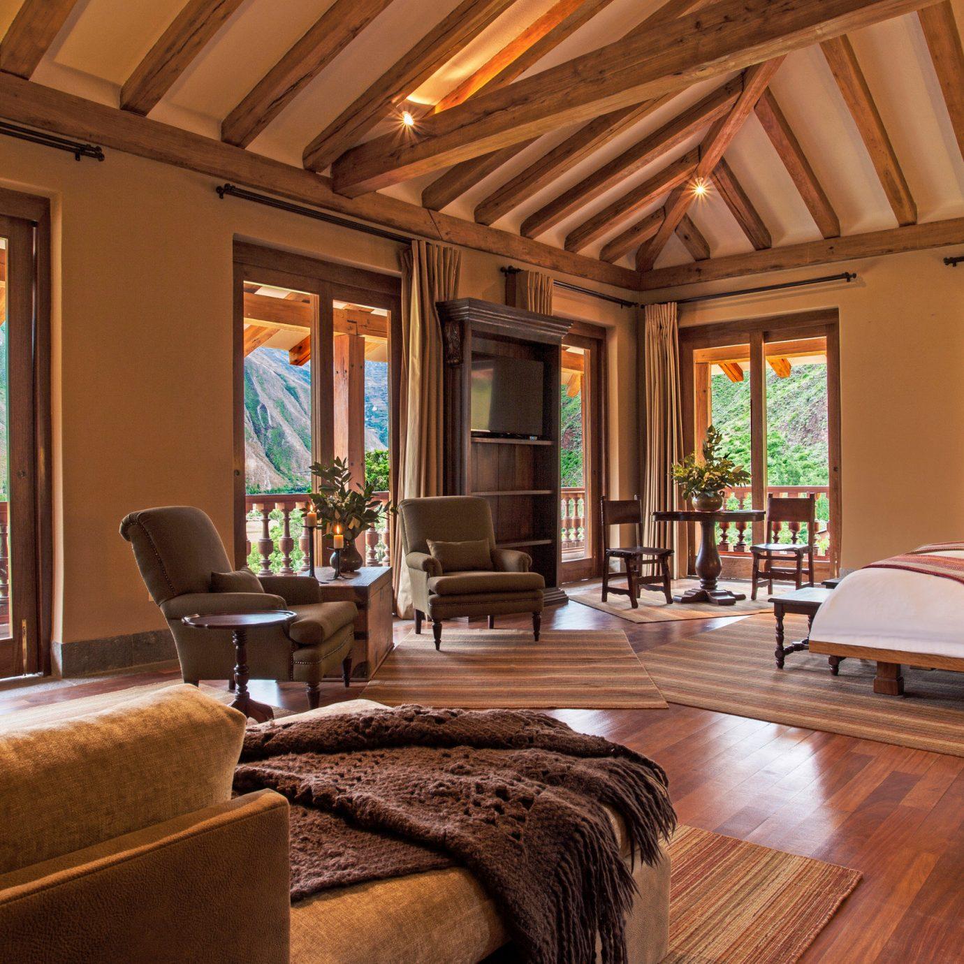 sofa property living room home Resort hardwood mansion Villa Suite wood flooring farmhouse cottage recreation room condominium