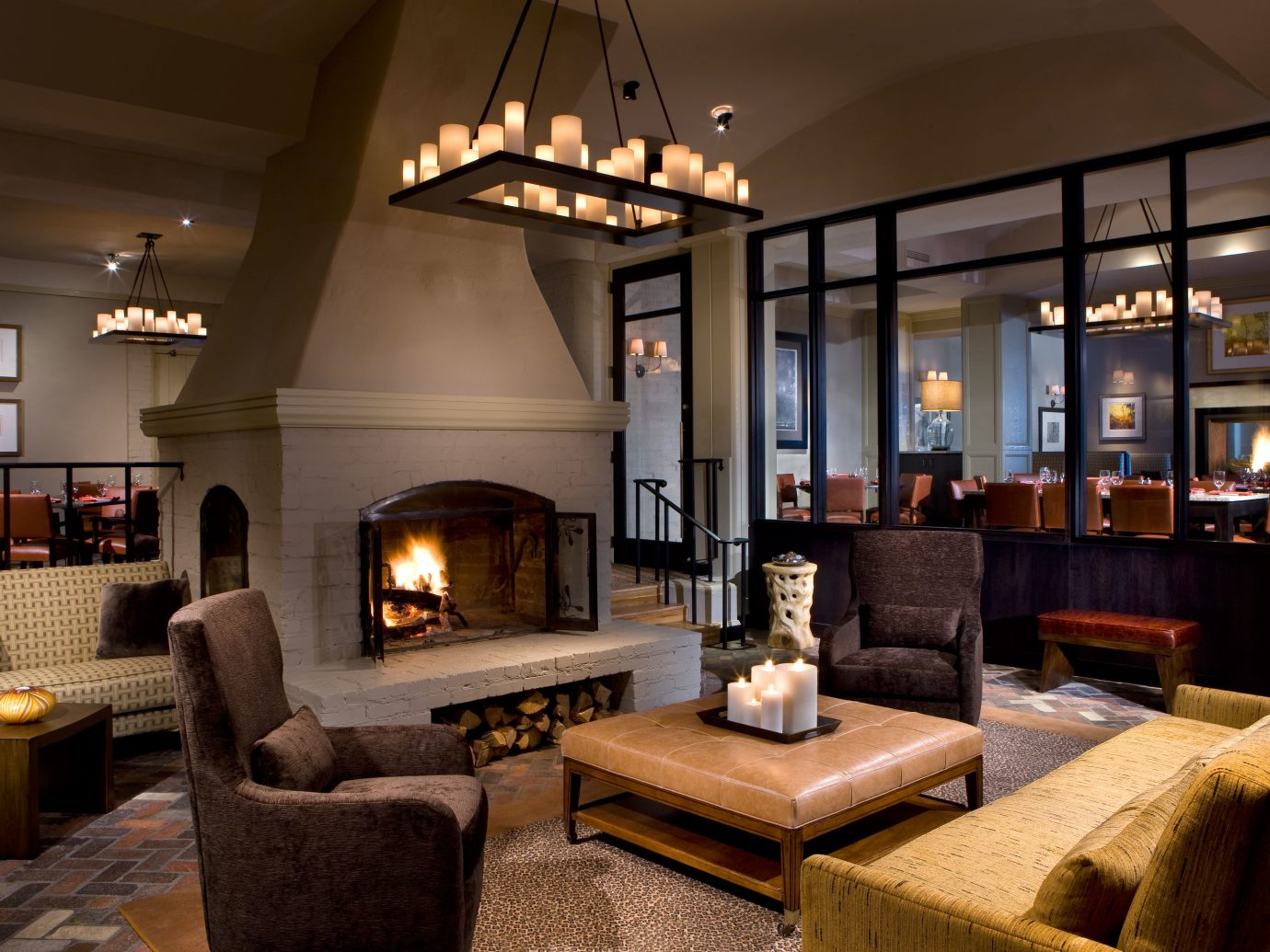 Design Fireplace Hotels Lounge Luxury Travel Mountains + Skiing Resort indoor Living floor room ceiling living room property fire estate home house interior design wood real estate cottage Villa mansion furniture area