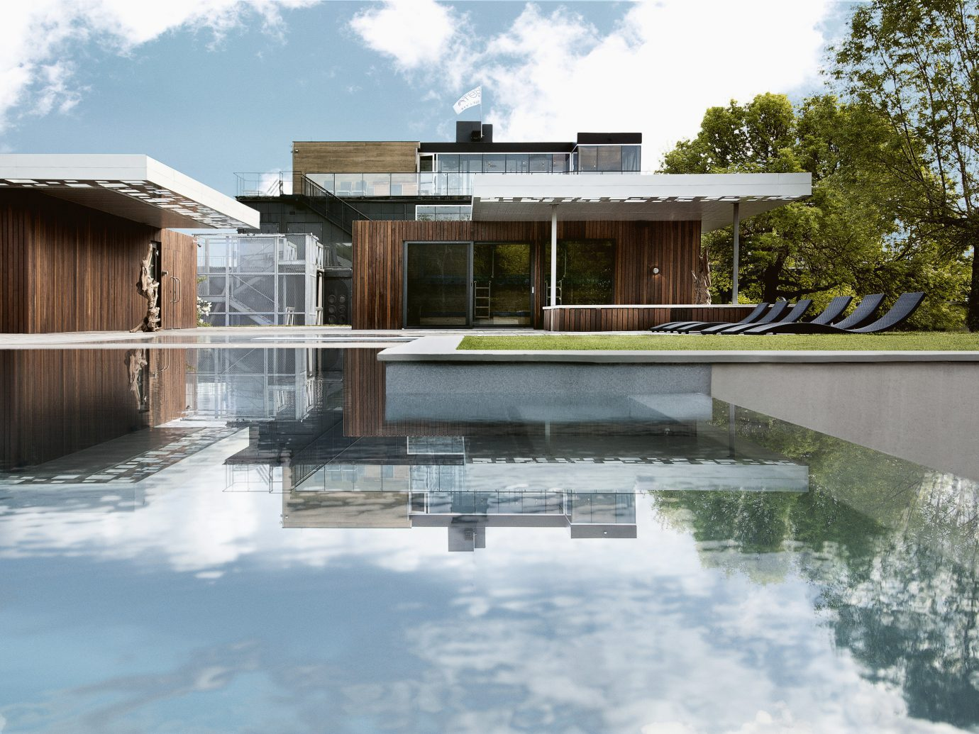 Trip Ideas outdoor sky tree swimming pool house property water home building estate Architecture backyard reflecting pool facade real estate Villa Courtyard outdoor structure