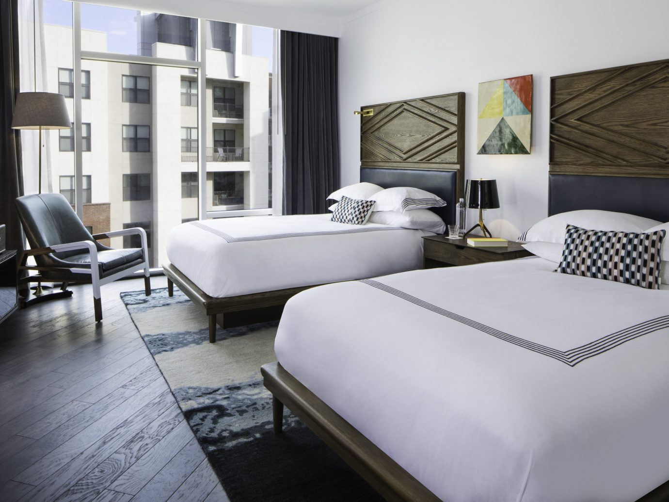 Hotels Trip Ideas indoor floor room sofa wall bed window property Living hotel living room Bedroom furniture interior design home Suite bed sheet real estate Design condominium pillow apartment decorated Modern