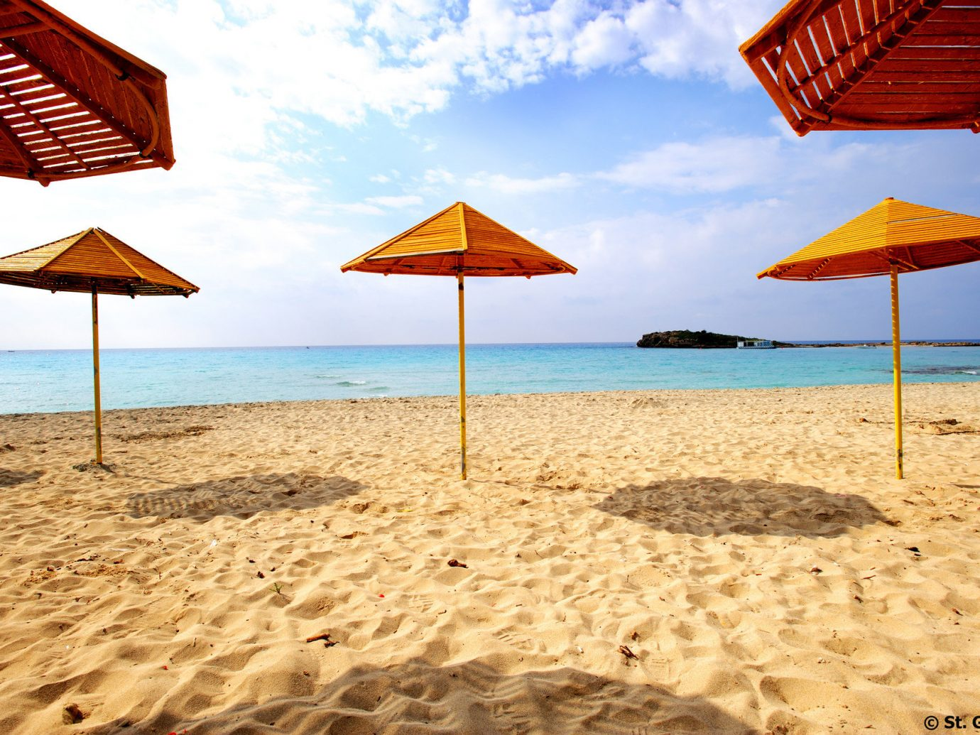 orange Travel Tips umbrella outdoor chair water Beach lawn shore body of water Sea Ocean Coast vacation lined sand set row line shade several swimming day