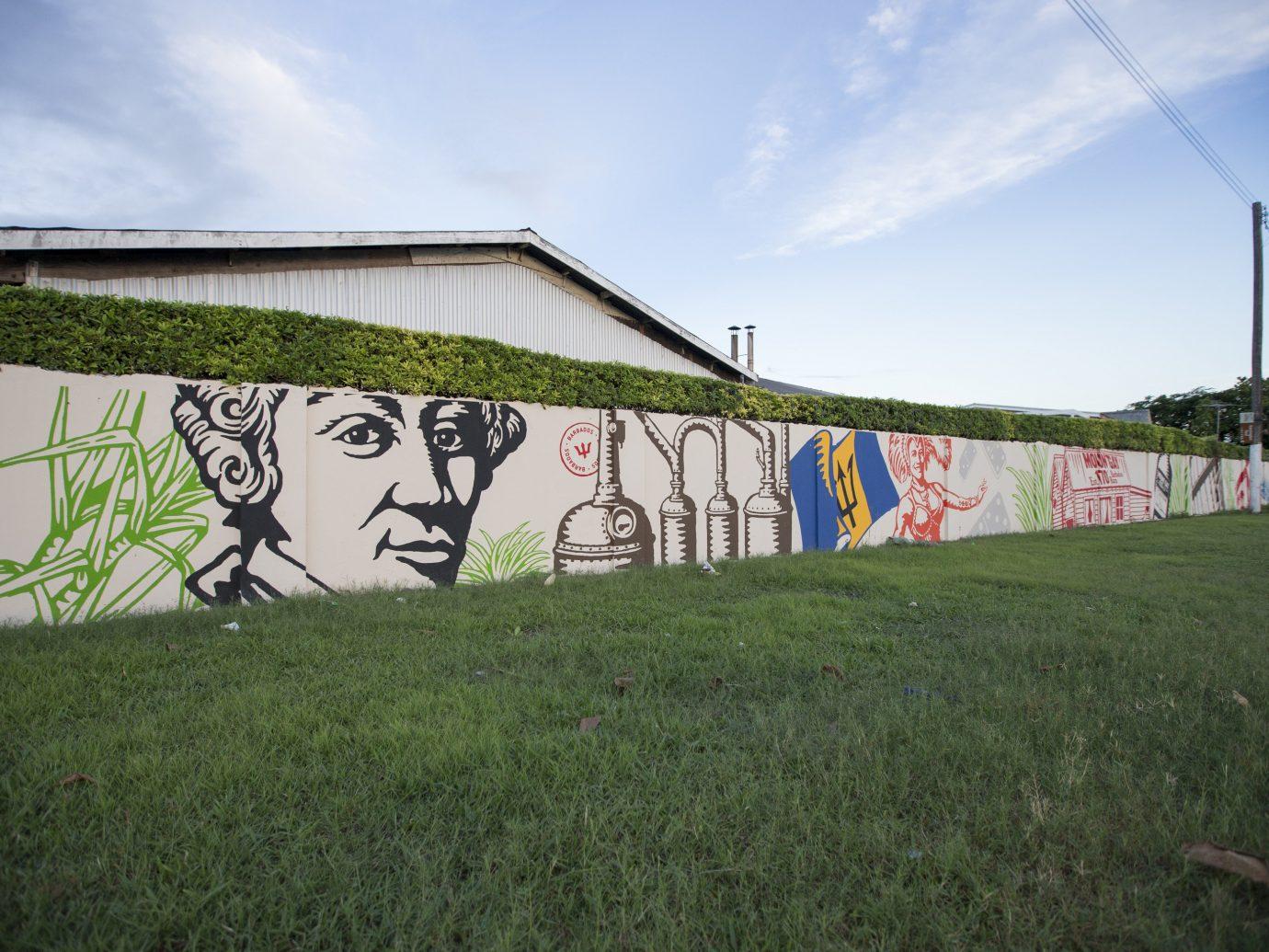 Trip Ideas grass sky outdoor field urban area wall art graffiti grassy mural stadium outdoor object lush day