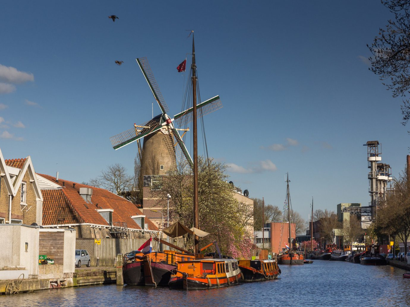 Trip Ideas outdoor sky water waterway Boat Canal tree building City River windmill plant evening channel