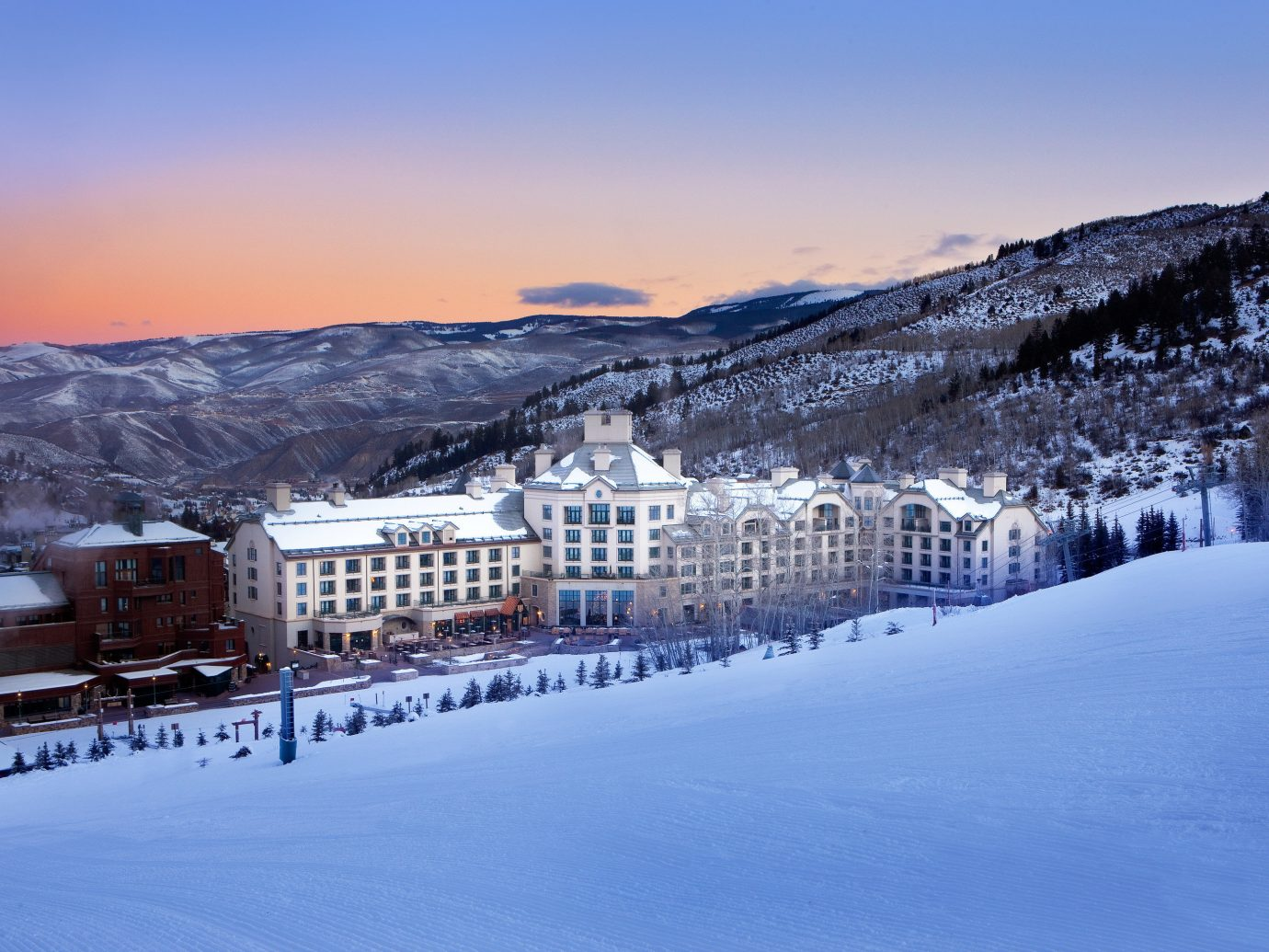 Hotels Luxury Travel Mountains + Skiing snow sky outdoor Winter mountainous landforms weather mountain season Nature mountain range freezing morning landscape evening sunlight piste ice dusk slope