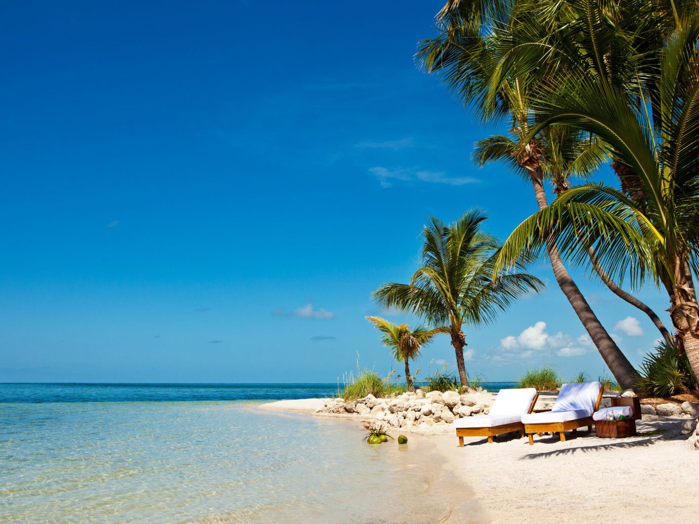 Beach Beachfront Hotels Island Outdoors Resort Romance Romantic Scenic views Secret Getaways Trip Ideas Waterfront sky outdoor water tree body of water Sea shore Ocean caribbean vacation Nature Coast tropics palm palm family arecales bay cape sand Lagoon sandy lined day