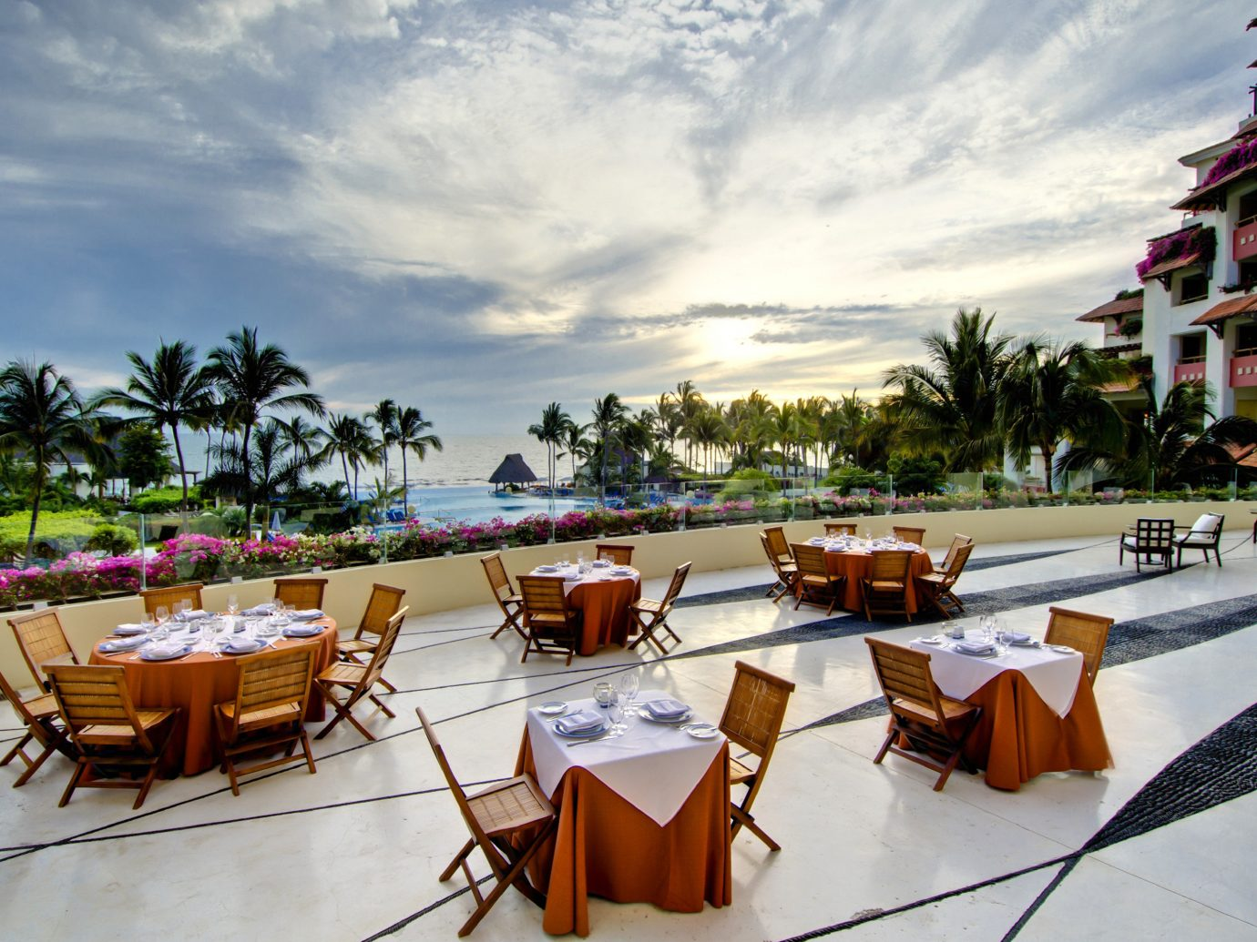 Balcony Beachfront Dining Drink Eat Hotels Outdoors Romance Romantic sky outdoor leisure chair vacation Resort Beach restaurant estate furniture