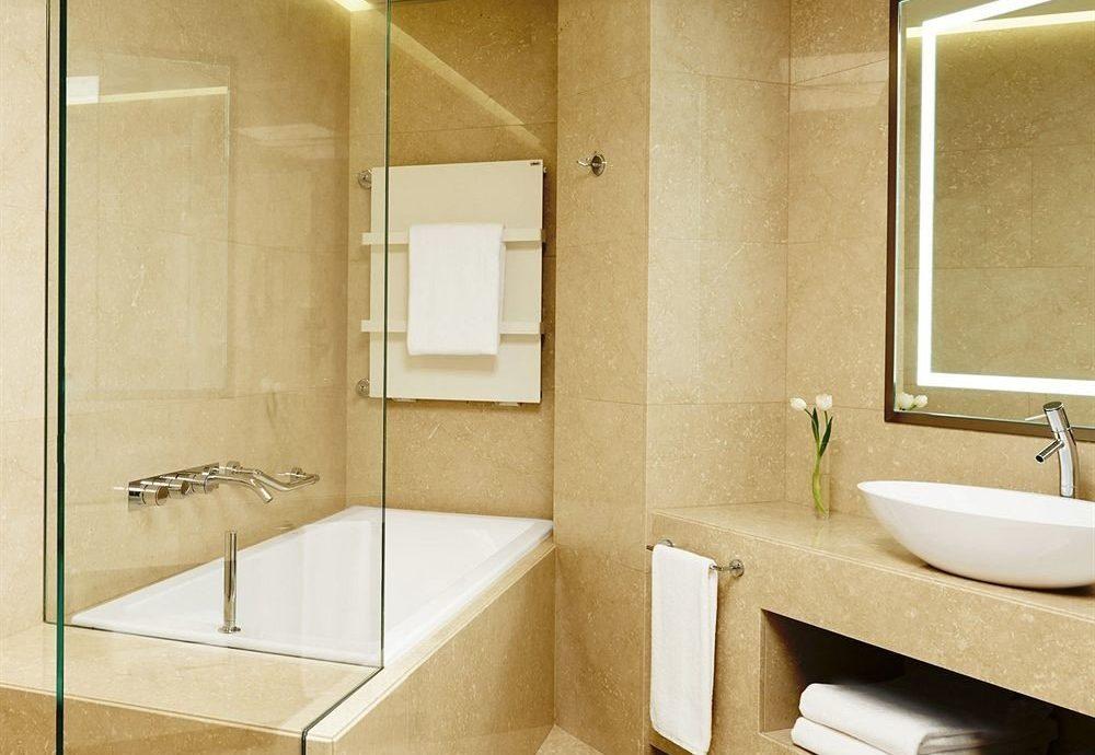 bathroom sink plumbing fixture Suite public toilet bathtub toilet tan