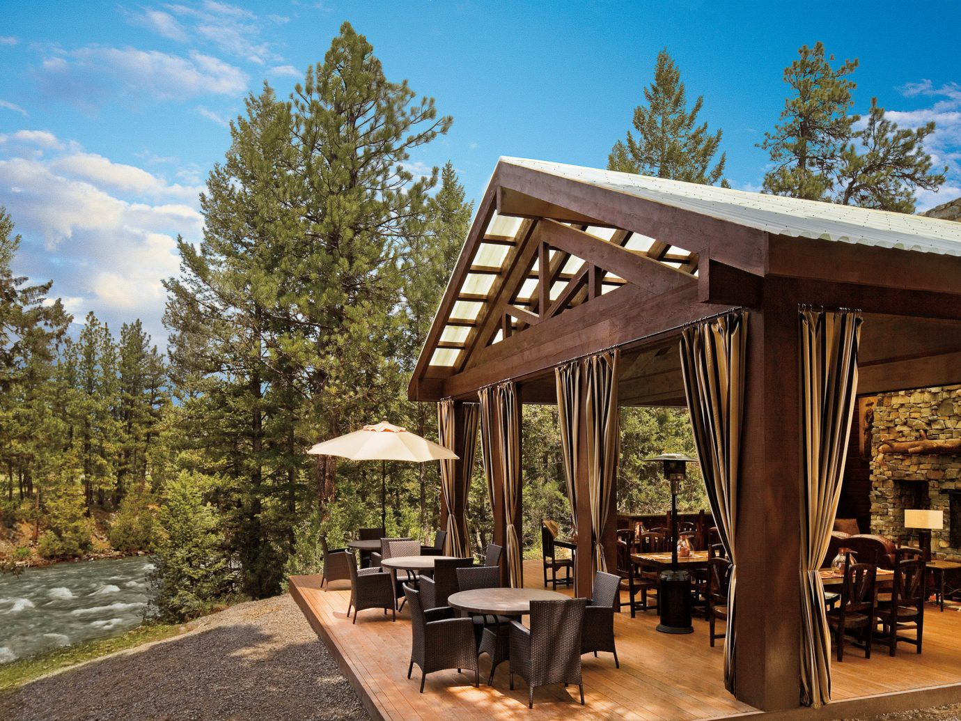 Glamping Hotels Montana Outdoors + Adventure Trip Ideas tree outdoor sky property building estate home log cabin real estate cottage outdoor structure Resort