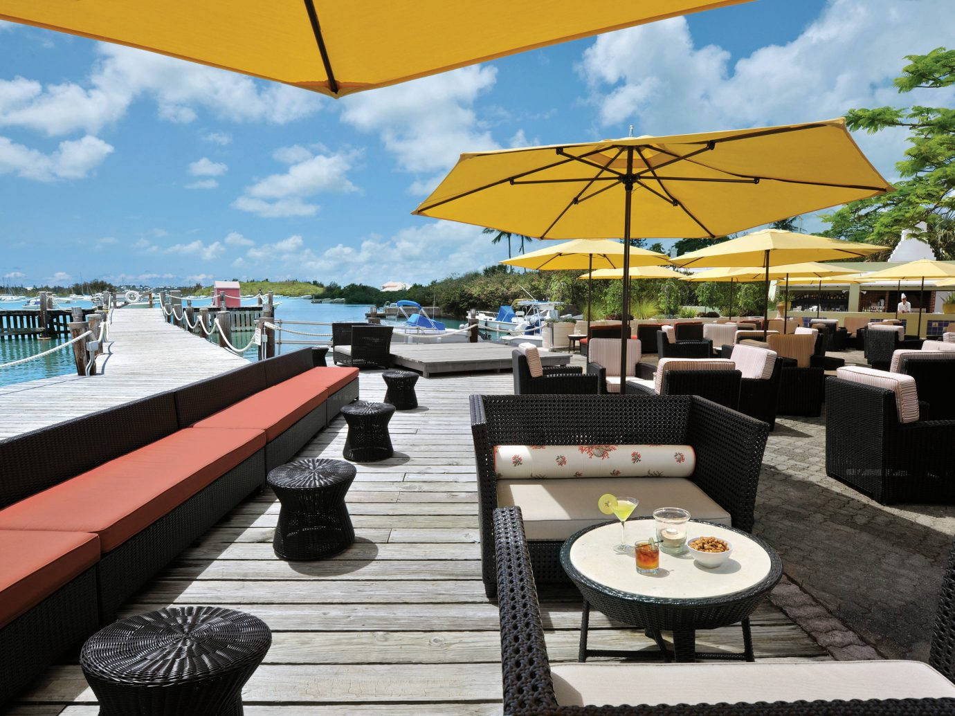 Bar Beachfront Dining Drink Eat Hotels Scenic views sky table outdoor leisure umbrella accessory restaurant vacation Resort vehicle yacht