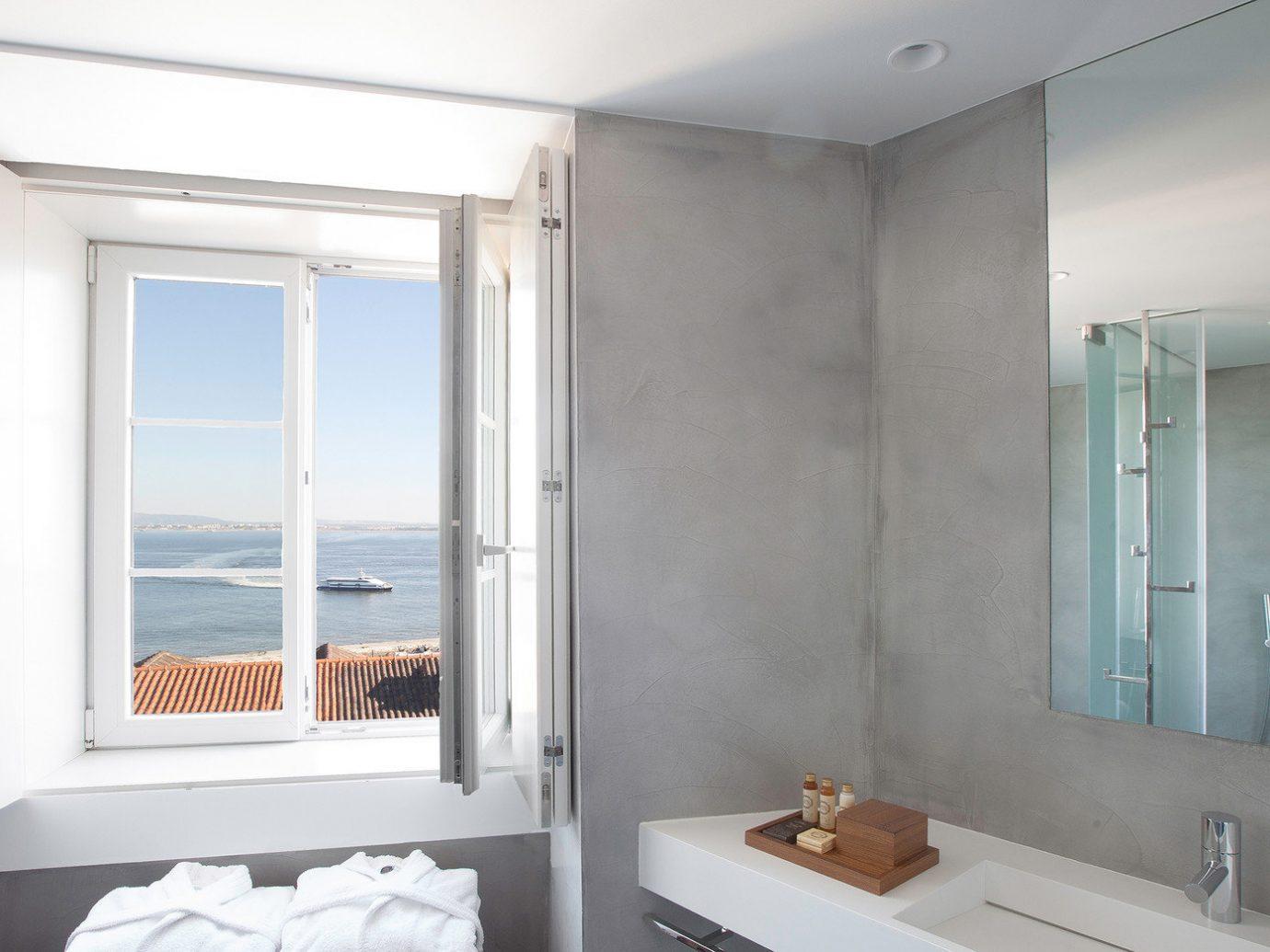 Hotels wall indoor bathroom room mirror property window white sink home interior design real estate apartment estate plumbing fixture